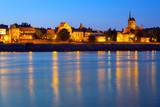 Old town of Torun at night reflected in Vistula river, Poland - 233211996