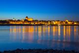 Old town of Torun at night reflected in Vistula river, Poland - 233212154
