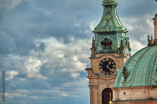 Close up view of the saint Nicholas church clock tower in Prague city with copy space