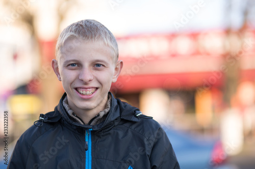 fototapeta na ścianę Portrait of a teen guy in a city