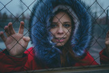Girl posing on the street, a student in street clothes in the winter. street style. emotional portraits - 233225734