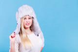 Blonde woman in winter furry hat - 233229128
