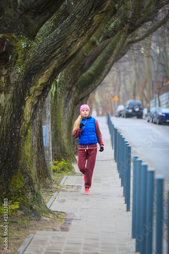 Sticker Woman wearing sportswear exercising outside during autumn