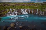 The Hraunfossar - an amazing blue cascade waterfall in Iceland - 233237796