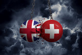 United Kingdom and Switzerland flag political balls smash into each other. 3D Rendering - 233238153