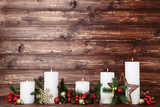 White christmas candles with fir tree branches and baubles on brown background - 233252972