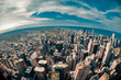 Fisheye aerial view looking down at the sprawling metropolis of Chicago Illinois with Lake Michigan in the background