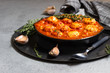 Spicy red beans, red bell pepper and meatball chili with thyme in the old frying pan. Grey concrete background. Copy space for text. - 233274758