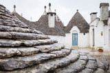 curved roof on the old house in Alberobello in Puglia in Italy - 233276704