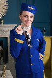 Pinup girl in suit of stewardess - 233281170
