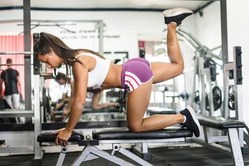 young woman doing exercises in gym © Miljan Živković