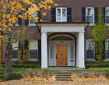 house with portico entrance and fall color - 233293943
