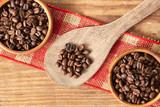 Coffee beans on wood spoon. - 233305359
