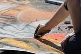 Sttreet artist drawing on pavement. - 233315160