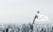 Leinwandbild Motiv Businesswoman or accountant on cloud floating high above modern