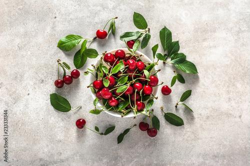 Foto Murales Fresh cherry on plate on white background, ripe cherries, sweet fruit, top view