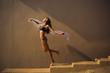 Leinwandbild Motiv girl in a bathing suit dancing in a beautiful light