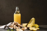 Bottle of homemade pineapple juice with ginger, lemon and ingredients. Horizontal. - 233344181