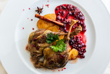 Duck leg confit with mountain cranberries sauce and pear chutney - 233347507