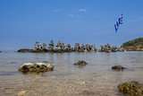 Stone pyramids in the bay by Faliraki, Rhodes Greece - 233367577