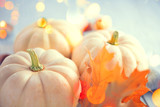 Thanksgiving background. Holiday scene. Wooden table, decorated with pumpkins, autumn leaves and candles - 233369349