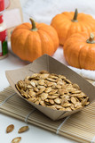 Homemade roasted spicy pumpkin seeds with cumin and brown sugar - 233371732