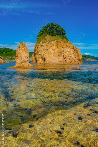 Foto Murales Red rocks in the sea