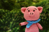 Knitted toy piggy on christmas decorations background. Chinese new year of the Pig, symbol 2019, Zodiac sign for greetings card - 233378780