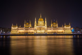 Hungarian Parliament Building on the bank of the Danube in Budapest at night - 233397143