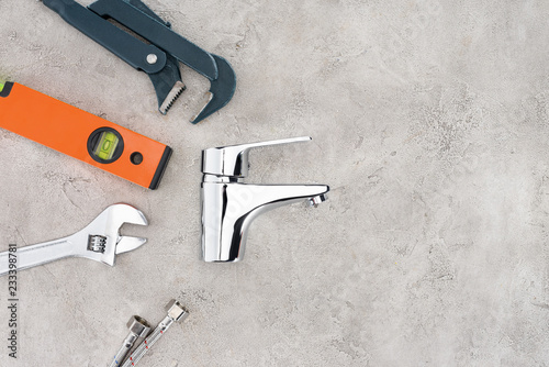 top view of water mixer and tools on concrete surface