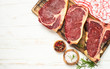 Leinwandbild Motiv Raw meat beef steak on white top view.
