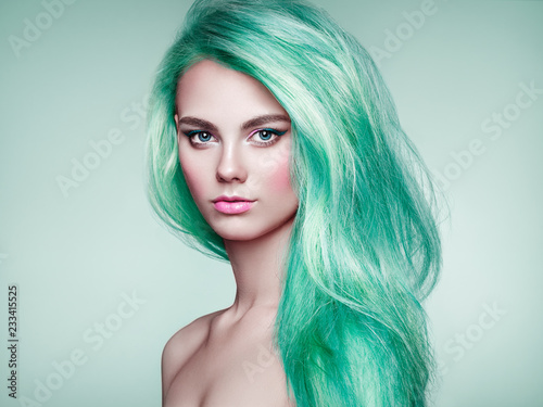 Leinwanddruck Bild Beauty Fashion Model Girl with Colorful Dyed Hair. Girl with perfect Makeup and Hairstyle. Model with perfect Healthy Dyed Hair. Green Hair