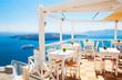 Cafe on the terrace overlooking the sea. Santorini island, Greece