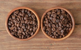 Coffee beans in wood bowls. - 233422977