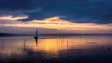 Yacht sailing at sunset - 233425756
