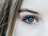 Green eyes of the girl close-up. Eye health. Optics. Contact lenses