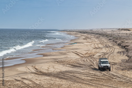 4x4 Jeep on the wild beach of the Namibe Desert. Angola. Africa.