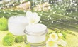 Quadro Cosmetic cream with white flowers on  table