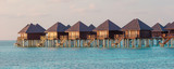 Water bungalows and wooden jetty on Maldives - 233439309
