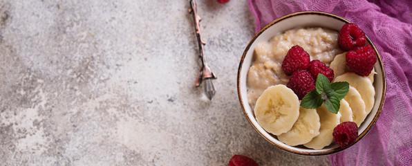Oatmeal with raspberry and banana © Yulia Furman
