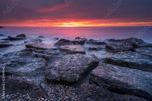 Foto Murales Sunrise over the sea