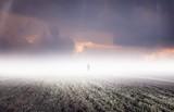 Silhouette of strange man standing in distant fog - 233455326
