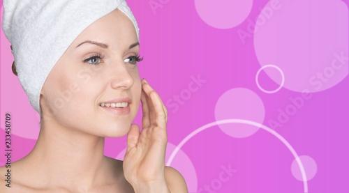 Leinwanddruck Bild Portrait of beautiful young woman  in white towel on head on