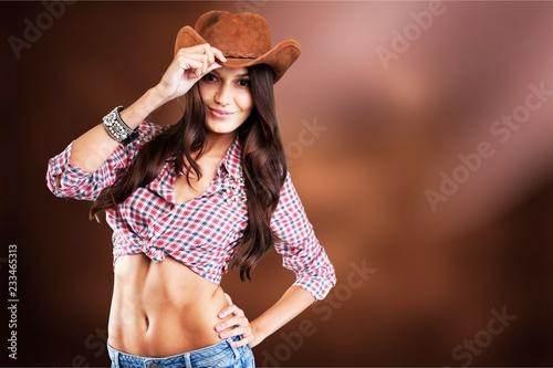 Leinwandbild Motiv Young sexy Woman wearing cowboy hat