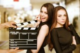 Attractive young women and clapper board - 233469918