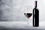 Red wine glass and bootle with shadow on withe background - 233471129