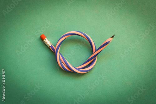 Leinwandbild Motiv Flexible pencil . Isolated on light background. Bending pencil