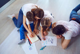 Top view of family drawing on the floor - 233498971