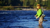 Rod and reel female casting line in freshwater river sunrise USA - 233501114