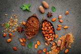 Cocoa powder and cacao beans on stone background. - 233503303